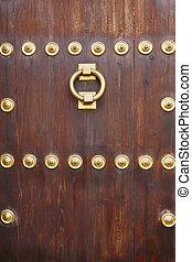 Antique bronze classic door knob on a wooden door