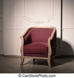 antique burgundy armchair in the interior