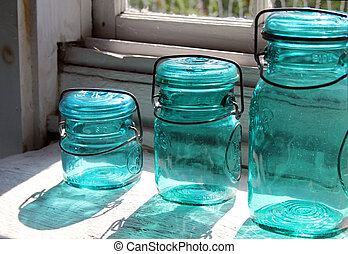 Antique Canning Jars - Antique blue canning jars with...