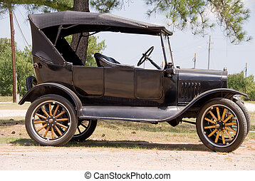 An old vintage antique car in mint condition.