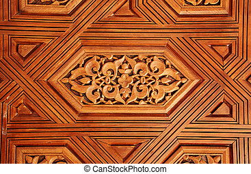Antique carved wooden ornament in Alhambra, Spain