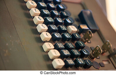Antique cash register for retail trade. Close up view with...