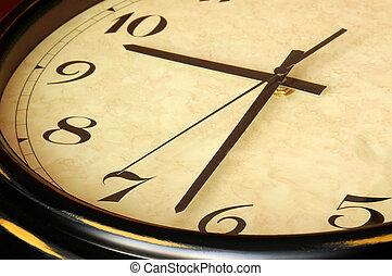 Antique clock detai - Antique wooden clock close up detail