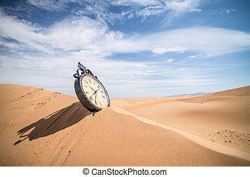 Antique clock in the desert - An antique clock ion the...