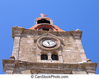 Antique clock on a stone tower