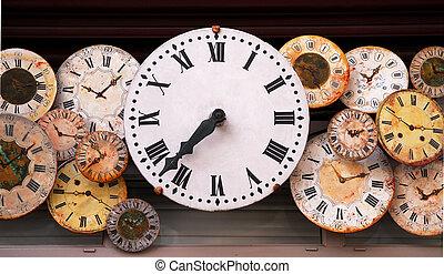 Antique clocks - Several antique clock faces of different...