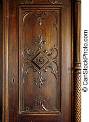 Antique closet door - A picture of a wooden carved door of ...