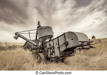 Antique combine left if a field to rot in Norther Idaho farm country