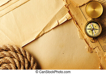Antique compass and rope over old map - Antique brass...