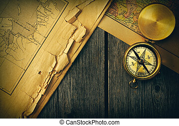 Antique compass over old map - Antique brass compass over...
