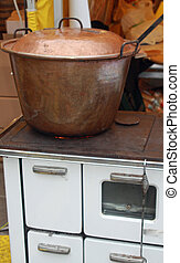 copper cauldron over an old wood stove