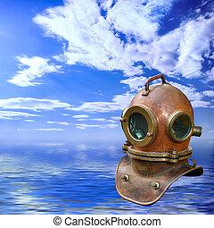 Antique diving helmet over seascape