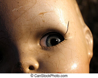 Antique doll close up - Antique doll face in strong...