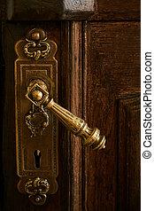 Antique doorknob on a wooden door
