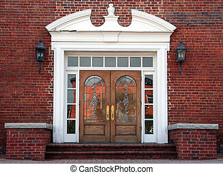 Antique double leaded glass doors on an old brick building