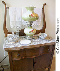 Antique Dresser and Lamp - Close-up of antique dresser with...