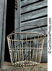 Antique Egg Basket - Antique, empty, egg basket sits in...