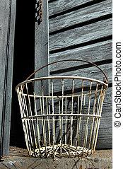 Antique Egg Basket - Antique, empty, egg basket sits in...