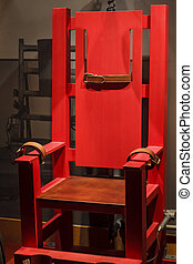 Antique Electric Chair with Leather Straps - An old red...