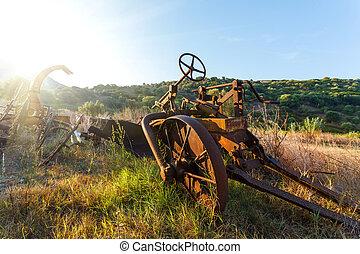 Antique Farm Equipment at sunrise, Italy