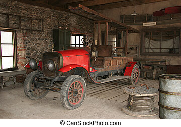Antique fire-engine at fire-department in the cinema town.