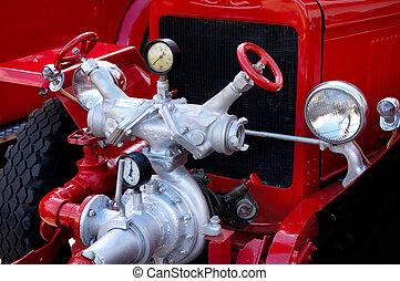 Antique Fire Engine - Closeup of antique red fire engine...
