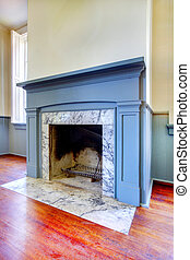 Antique fireplace with blue mental and white marble from 1856.