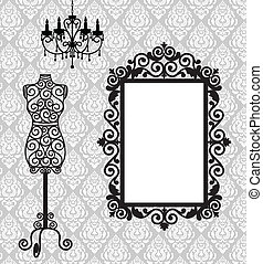 Antique frame, mannequin and chandelier