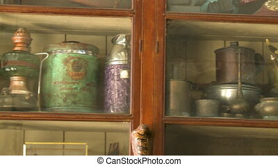 Antique gas lamps on display in a glass cabinet