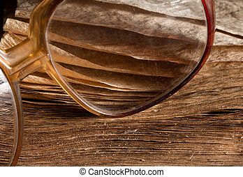 Antique glasses on old weathered book