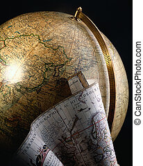 Antique globe and map of the world - An antique globe...