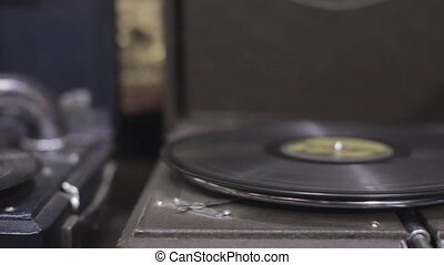 Antique gramophone - Vintage musical disc rotates on the...