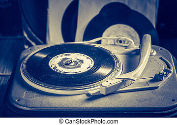 Antique gramophone with a stack of vinyl records