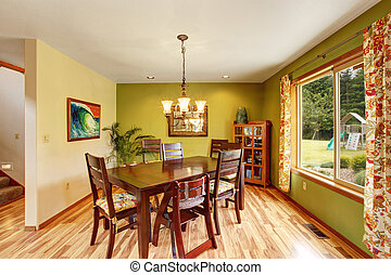 Antique green dining room interior with mahogany table set...
