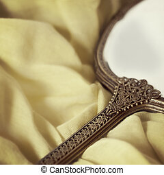 Antique Hand Mirror over Soft Fabric - Antique gilded hand...