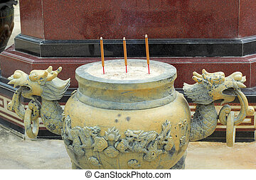 Antique incense burner in temple