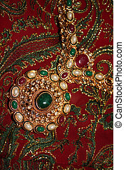 An antique jewelery set in traditional Indian design, studed with precious gemstones.