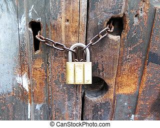 Antique key lock chain on wooden door