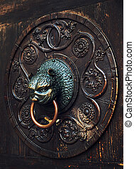 Antique knob on a wooden door, Augsburg, Germany - Antique...