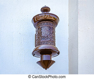 Antique lamp on the wall