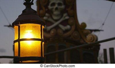 Antique lantern near a skull and bones monument in Paris in...