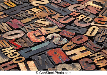 antique wood letterpress printing blocks with color ink patina, random collection of different size and style