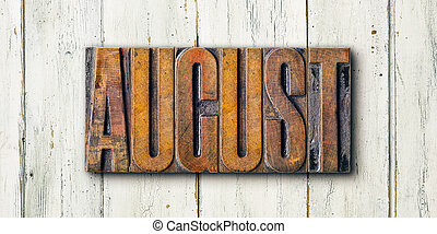 Antique letterpress wood type printing blocks on a white backgound - August