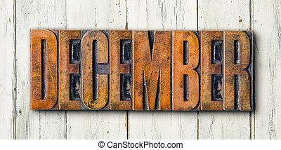 Antique letterpress wood type printing blocks on a white backgound - December
