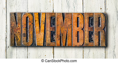 Antique letterpress wood type printing blocks on a white backgound - November