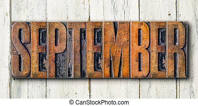 Antique letterpress wood type printing blocks on a white backgound - September