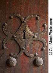 Antique lock. Metallic and wood.