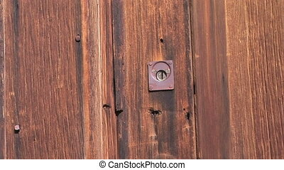 Antique Lock - Weathered door and lock in the ghost town of...