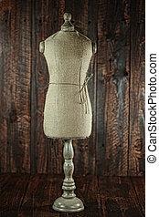 Antique Mannequin Busts on Wood Grunge Background