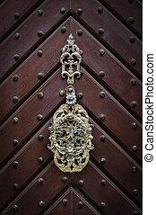 Antique metal door knocker